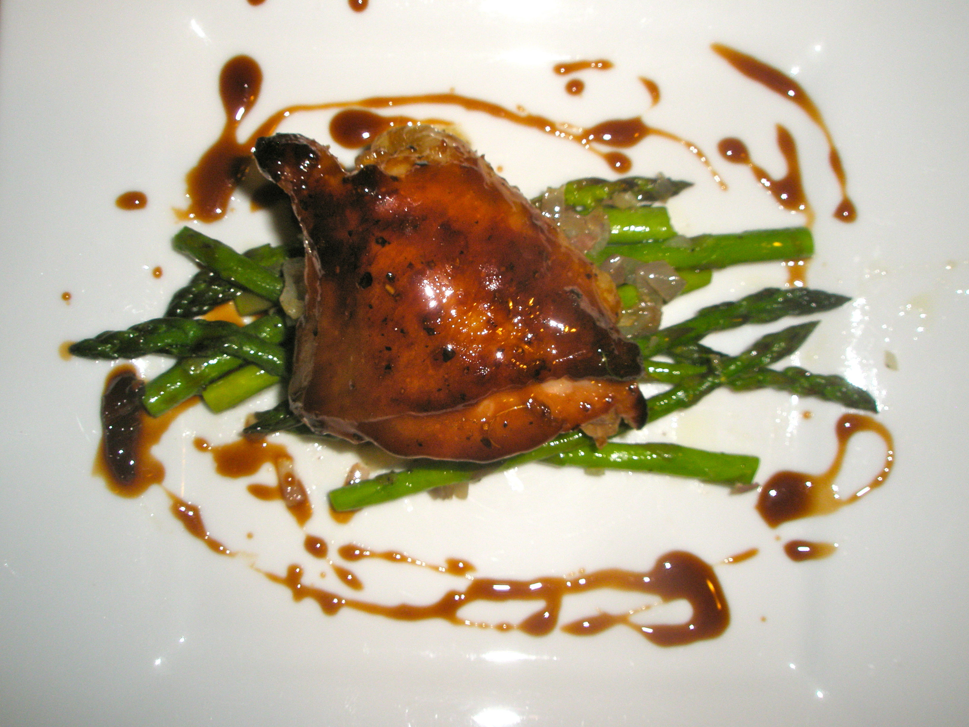 Grilled Honey-Teriyaki Chicken on a bed of asparagus