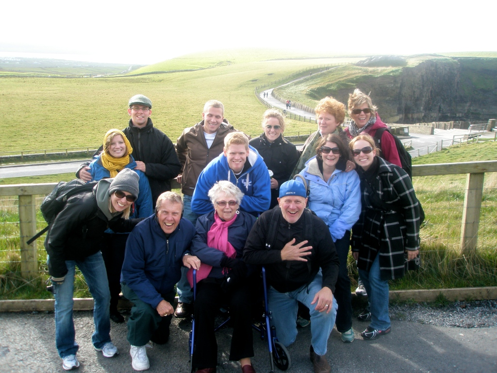 The Linnemann family strikes a pose at the base of the Cliffs of Moher.